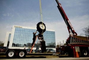 Workers from Artlite Signs & Awnings get ready to move the Hardy's Jewellers clock onto its new foundation on 21st Street near Mediterranean Avenue in Virginia Beach. The clock's pedestal was designed in 1884. (Todd Spencer | The Virginian-Pilot)